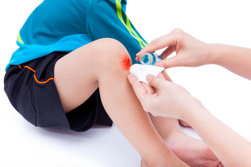 clean and provides first-aid at wound on leg