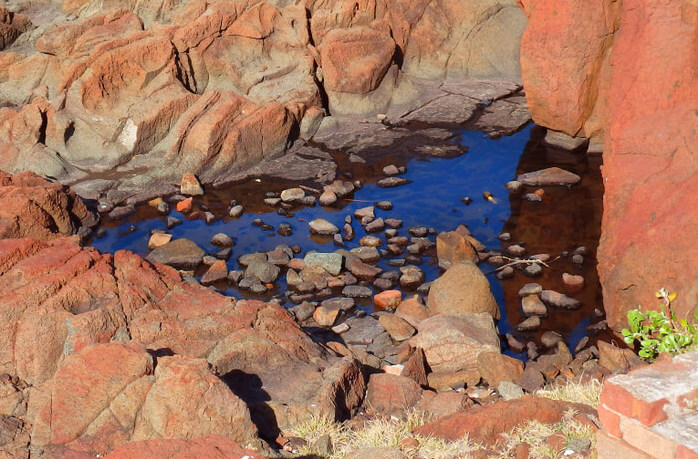 rain water on rock formation on a desert in the outback